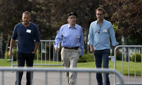 Rupert Murdoch, center, Chairman and CEO of News Corporation, walks with his sons Lachian Murdoch, left, and James Murdoch, right, at the Allen & Company Sun Valley Conference in Sun Valley, Idaho on Tuesday, July 9, 2013.