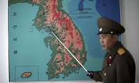 North Korean People's Army Lt. Col. Nam Dong Ho points to a map showing the line which separates the two Koreas in Panmunjom at the Demilitarized Zone (DMZ), February 22, 2016, in Panmunjom, North Korea. (AP Photo/Wong Maye-E)