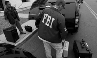 FBI agents leave a raid in Trenton, N.J. on July 19, 2012