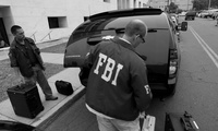 FBI agents leaving a raid.