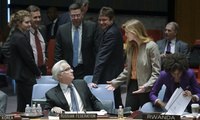 Russia's late U.N. Ambassador Vitaly Churkin, left, and United States' former U.N. Ambassador Samantha Power interact before an U.N. Security Council meeting on the Ukraine crisis, Saturday, March 15, 2014, at the United Nations headquarters. (AP Photo/John Minchillo)