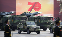 Chinese military vehicles in parade.