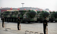 Chinese military vehicles carrying DF-41 ballistic missiles roll during a parade to commemorate the 70th anniversary of the founding of Communist China in Beijing, Tuesday, Oct. 1, 2019. Trucks carrying weapons including a nuclear-armed missile designed to evade U.S. defenses rumbled through Beijing as the Communist Party celebrated its 70th anniversary in power with a parade Tuesday that showcased China's ambition as a rising global force.