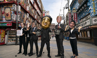 Environmental activists wear masks depicting world leaders during the G-20 Summit in Japan
