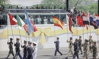 Soldiers marching with national flags in parade