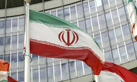 The Iranian flag waves outside of the UN building that hosts the International Atomic Energy Agency