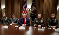 President Donald Trump, joined by from left, Gen. David Berger, Defense Secretary Mark Esper, and Chairman of the Joint Chiefs of Staff Gen. Mark Milley, and Gen. Joseph M. Martin, pauses as he speaks to media during a briefing with senior military leaders in the Cabinet Room at the White House in Washington, Monday, Oct. 7, 2019.