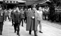 Chinese Nationalist President Chiang Kai-shek, center, and other top Nationalist government officials walk from the Yuanshan Martyrs shrine in Taipei, Taiwan, Tuesday, March 29, 1955. The leaders payed homage to the revolutionary martyrs and those killed in the struggle with the Chinese communists.