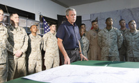 George W. Bush and military members in briefing