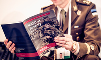 Estonian Military Officer reading NATO at 70