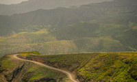 A narrow road along a lush mountain slope in Ethiopia