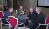 Ambassador Douglas Lute (2nd from right) and BG Kevin Ryan (right) confer with Russian General Anatoly Kulikov during a break in their conference at the Russian General Staff Academy. Also pictured (left to right): Russian Elbe Group Executive Director Mr. Victor Kulikov and interpreter Ms. Elena Mareeva (interpreter).