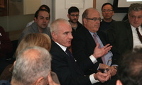 Leonardo Maugeri (center) discusses oil production and prices at a Belfer Center seminar. (Bennett Craig)