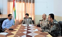 Morgan Kaplan (left) with Kamal Kirkuki (center), a senior member of KDP Polit Bureau and Head of KDP Public Relations, and members of his command during a briefing on the security situation around Kirkuk, Iraq, in June 2015.
