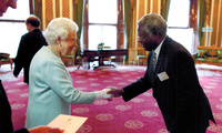 Calestous Juma meets with Queen Elizabeth II at Buckingham Palace to celebrate the first Queen Elizabeth Prize for Engineering