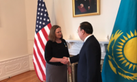 Kazakh Ambassador Erzhan Kazykhanov thanks Ambassador Laura Holgate for her service to his country.