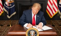 "President Trump signs an Executive Order in Bedminster, New Jersey, entitled ""Reimposing Certain Sanctions with Respect to Iran."""