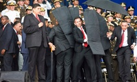 Security personnel surround Venezuelan President Nicolás Maduro during an incident as he was giving a speech in Caracas on Saturday.