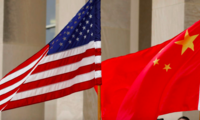 A U.S. flag flies beside a Chinese flag