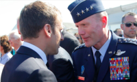 French President Emmanuel Macron, meets with Gen. Tod Wolters, while visiting the Paris Air Show in Le Bourget, north of Paris, on June 19, 2017