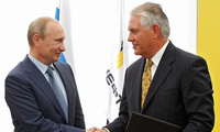 Russian President Vladimir Putin, left, and Sec. of State Rex Tillerson shake hands at a signing ceremony in southern Russia, Friday, June 15, 2012.