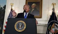 "President Donald Trump speaks about Iran from the Diplomatic Reception Room at the White House in Washington, Friday, Oct. 13, 2017. Trump says Iran is not living up to the ""spirit"" of the nuclear deal that it signed in 2015, and announced a new strategy in the speech. He says the administration will impose additional sanctions on the regime to block its financing of terrorism."