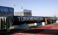"Symbolic pipes with a sign that reads ""Turkmenistan—China"" on exhibit at the Bagtyyarlyk natural gas field, Turkmenistan, Aug. 29, 2007."
