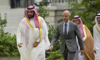 Saudi Arabia's Deputy Crown Prince Mohammed bin Salman, left, walks into the West Wing of the White House in Washington escorted by Deputy Chief of Protocol Mark E. Walsh, right, Friday, June 17, 2016.