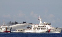 Chinese Coast Guard and Vietnamese Coast Guard ships at sea