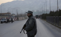 Jan. 10, 2017: a member of the Afghan security forces stands guard near the site of two blasts in Kabul, Afghanistan