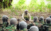 Al-Shabab's spokesman, Ali Mohamud Rage, speaks to Kenyan foreign fighters at one of the Islamist insurgent group's military training camps in Somalia in 2017.