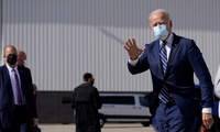 Joe Biden waves as he arrives at Detroit Metropolitan Wayne County Airport
