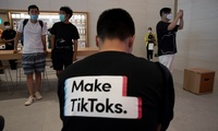 man wearing a shirt promoting TikTok