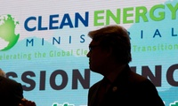 "U.S. Energy Secretary Rick Perry is silhouetted near the words ""Clean Energy"""