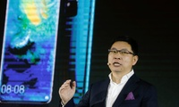 Richard Yu, CEO of Huawei Technologies' consumer business group, unveils a smartphone compatible with the company's new 5G chipset.