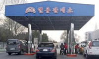 Cars line up at at a gas station in Pyongyang, North Korea