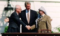 U.S. President Bill Clinton, Israeli Prime Minister Yitzhak Rabin and Palestinian leader Yasser Arafat sign the historic Oslo accord at the White House in September 1993.