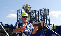 Stan Osserman, director of the Hawaii Center for Advanced Transportation Technologies, speaks in front of a new waste to energy facility at Joint Base Pearl Harbor-Hickam, Hawaii.