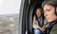 Sen. Chuck Grassley, R-Iowa, and Sen. Joni Ernst, R-Iowa, survey the flooded areas around the Missouri River in Iowa from a helicopter