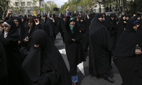 Protesters chant slogans in a rally in Tehran