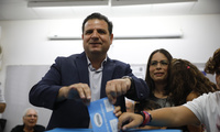 Israeli Arab politician Ayman Odeh casts his vote in Haifa