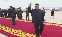 Kim Jong Un waves to hundreds of well-wishers as he returns to North Korea
