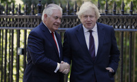 Boris Johnson greets Rex Tillerson, outside Carlton Gardens in London