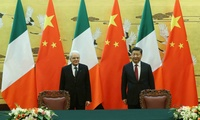 Chinese President Xi Jinping (R) and Italian President Sergio Mattarella attend a signing ceremony at the Great Hall of the People in Beijing on February 22, 2017.