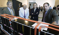 U.S. Energy Secretary Steven Chu, second from right, listens as Jason Forcier, right, Vice President and General Manager of A123 Systems, shows off a battery