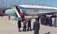The Nixons disembark from Air Force One upon their arrival in China, 1972.
