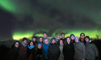 Arctic Views:  Harvard Kennedy School students and staff experience the northern lights in Iceland during their participation in the 2017 Arctic Circle Assembly in October.