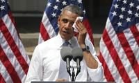 President Barack Obama wipes perspiration from his face as he speaks about climate change