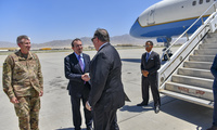 U.S. Secretary of State Michael R. Pompeo is greeted by U.S. Ambassador to Afghanistan John Bass and General John Nicholson upon arrival to Bagram Airfield