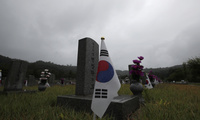 South Korean national flags are placed near the gravestones